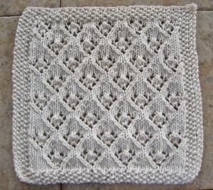 Knitted elfin lace pattern dishcloth